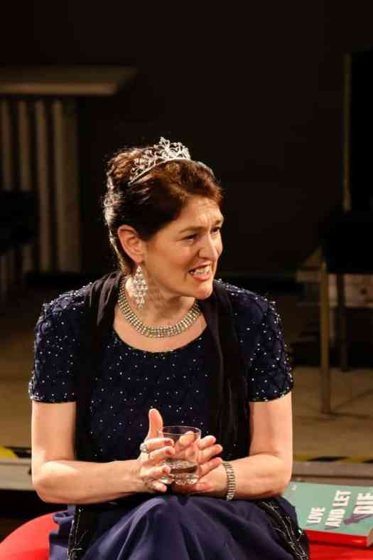 Photo of a Marie Cooper actor playing a tired and grumpy Anna Mary after the dinner party onstage during Come into the Garden, Maud