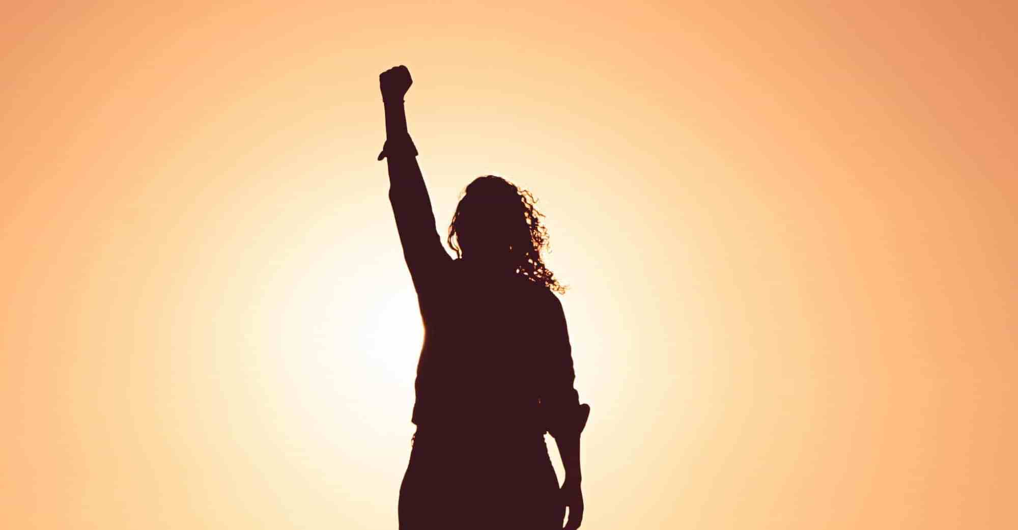Image of woman, fist in the air