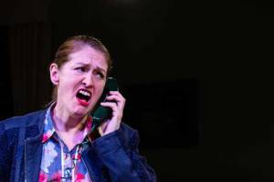 Image of Marie Cooper performing in Murder in Neighbourhood watch as Ann Wingate is on the telephone with an anonymous caller