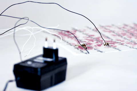 Rose Petals is a thermochromicly (heat sensitive) printed nowoven with embroidered heat circuits. Photo: Henrik Bengtsson (Imaginaria)