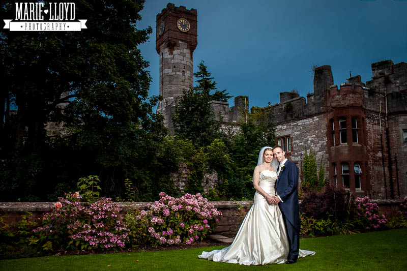Evening portrait of the wedding couple at Ruthin Castle by wedding photographer Marie Lloyd