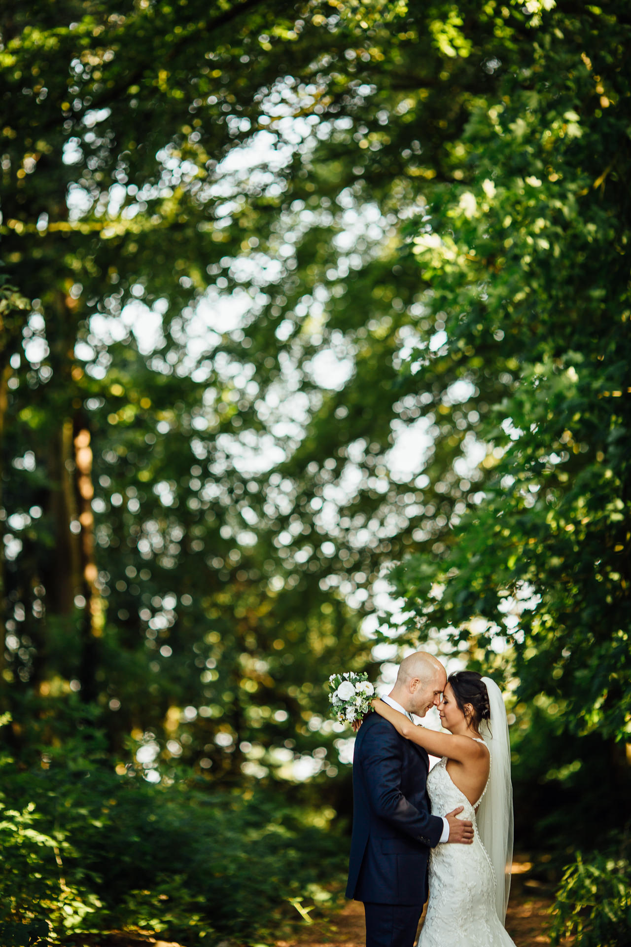 WEDDING PHOTOGRAPHY inglewood manor bride and groom hugging