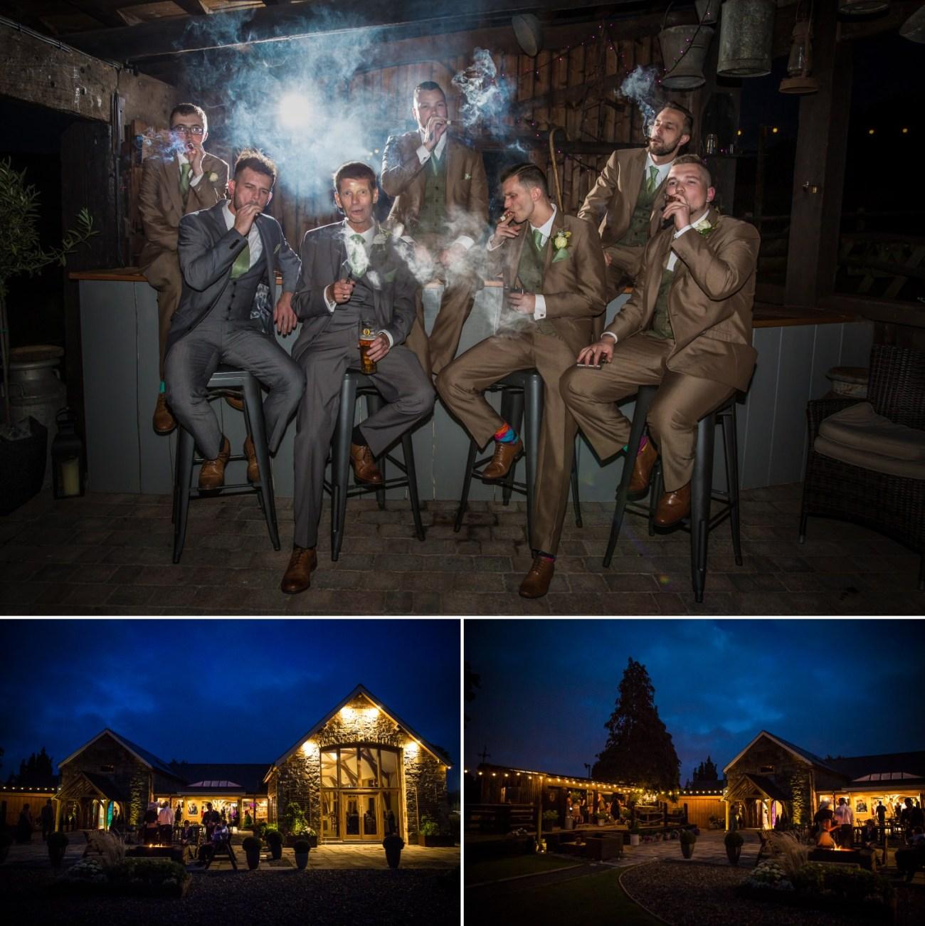 Wedding photography of guys smoking cigars at Tower Hill Barns, North Wales