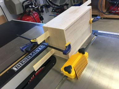 Separating the lid from the body on the tablesaw.