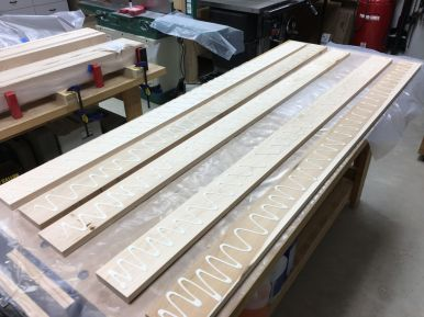 Applying glue to five boards at a time for glue up of the top slab
