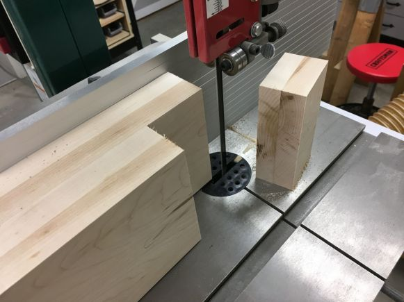 Using the bandsaw to make the cheek cuts for the leg tenons