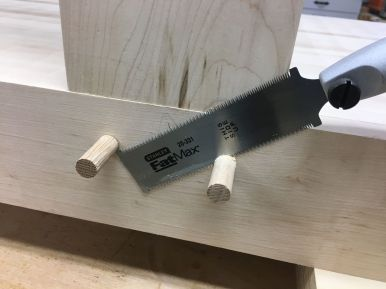 Trimming oak pegs with a flush cut saw