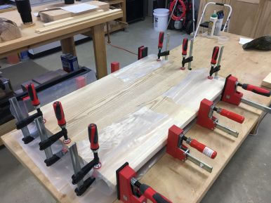Since PVA glue is slippery until it cures, the small clamps keep the boards aligned at their interfaces.