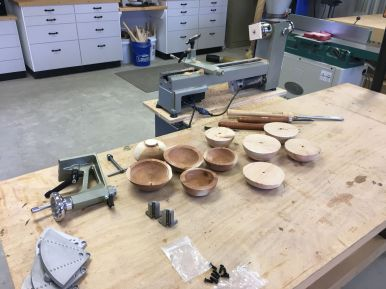 Reverse view of my work area, with bowl blanks in various stages on the workbench