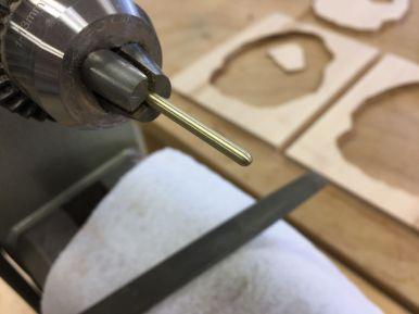 Closeup of brass pin with bullet nose