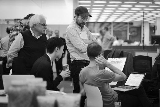 Tom Bodkin, left, looking over a mock-up of a possible front page for Wednesday's New York Times. Credit Stephen Hiltner/The New York Times