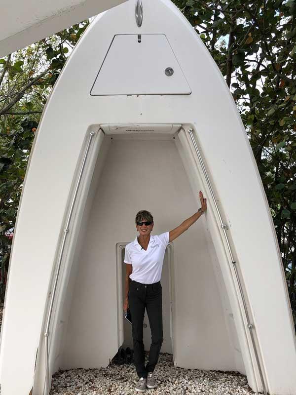 Marilyn DeMartini standing inside a Sea Hunter Hull