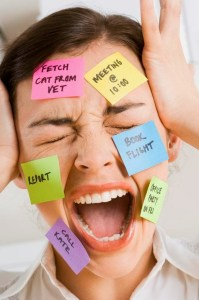 Screaming businesswoman with sticky notes on face