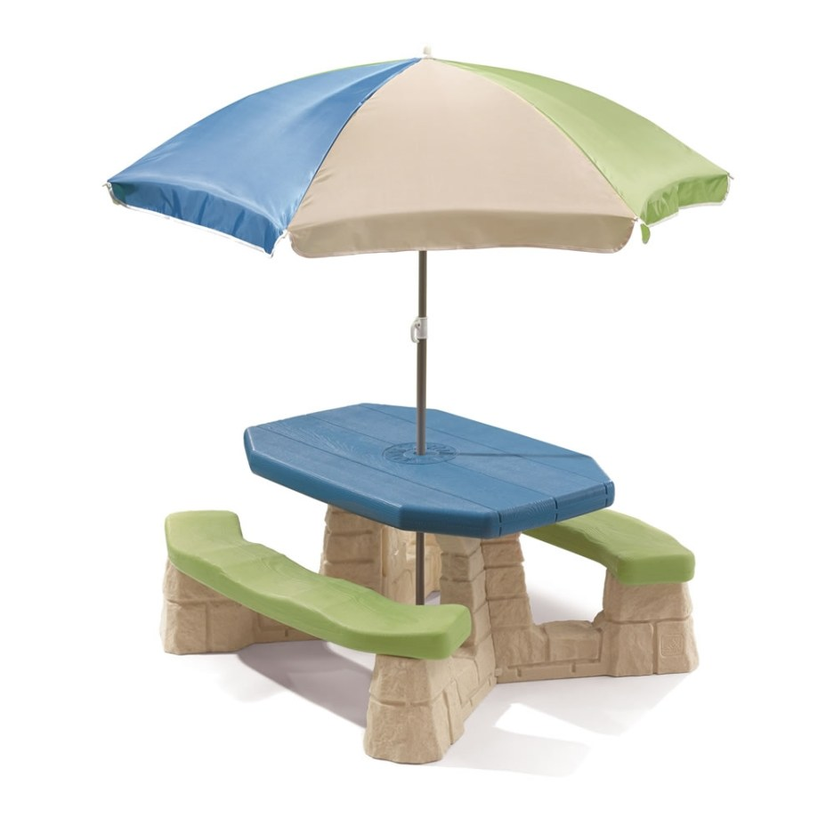 naturally playful picnic table with umbrella
