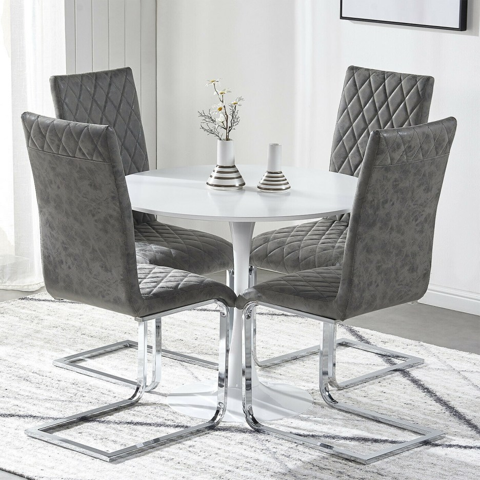small round dining table and 24 chairs grey distressed faux leather chrome set