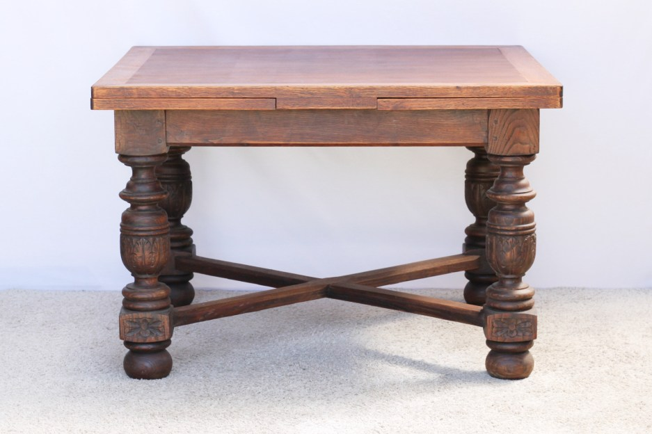 draw leaf oak dining table with carved legs