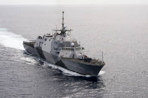 The littoral combat ship USS Freedom (LCS 1) arrives at Joint Base Pearl Harbor-Hickam, Dec. 13, 2013. Freedom's first operational deployment, a 9-month assignment forward-operating from Singapore, is the first ever deployment for a littoral combat ship and the proof-of-concept deployment for the ship class. (U.S. Navy photo by Johans Chavarro)