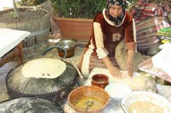photo of a woman making some Lebanese flat breads