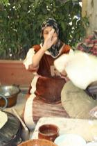 photo of a Woman making some lebanese bread