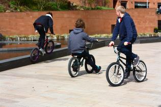 Three Boys playing on bikes