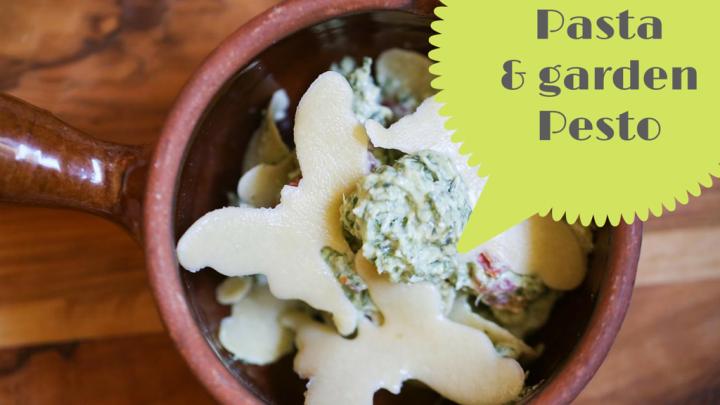 Homemade butterfly pasta and garden pesto