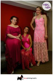U&I formal dresses designed in pink to raise breast cancer awareness. Dresses in different tones of pink, some with shimmer and some with bling.