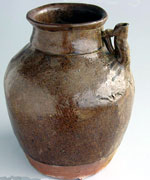 brown-glazed spouted jar