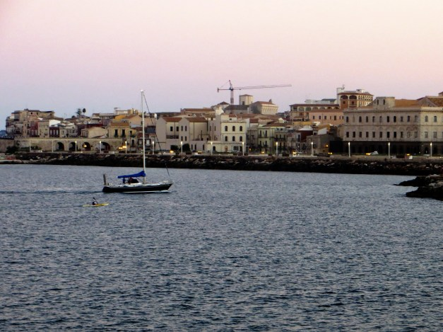 Looking across the harbor from our beach at Ortygia and the city center