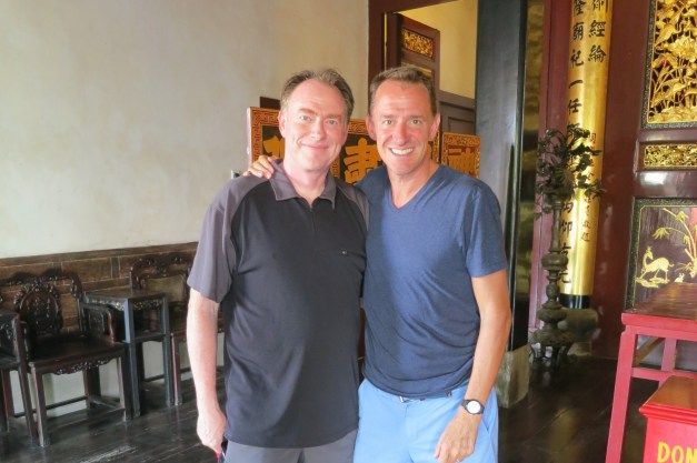 Mark & his brother John in a Buddhist temple