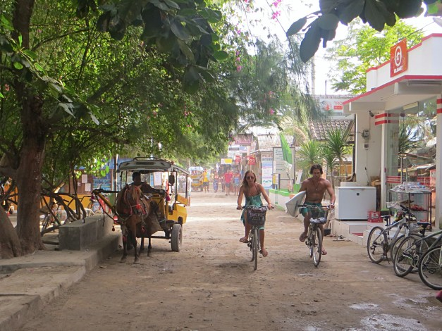 The road in town is busy with locals and tourists alike going about their business