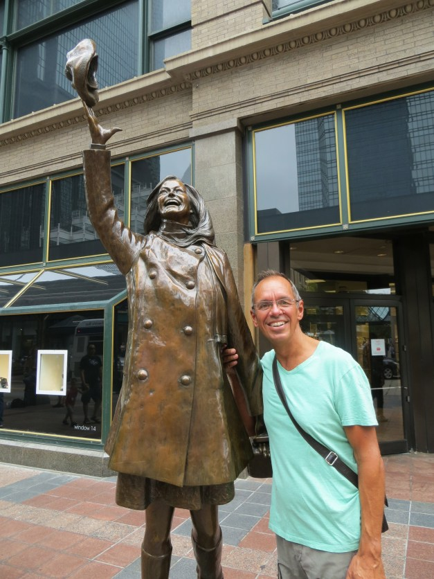 Here I am with a statue of the inimitable Mary Tyler Moore throwing her hat in the air. If you're old enough you will recall, of course, that the Mary Tyler Moore show took place here.