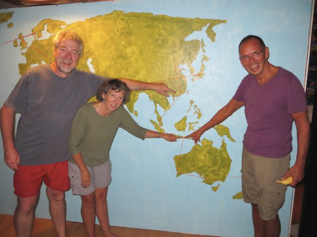Ann and Wil were recently in the midst of building this cool big map of their 8-month journey around the world earlier this year. Here Ann and Jim point to where we all got together in Bali, and Bart points to, well, something else. And Jim is inexplicably holding a banana.