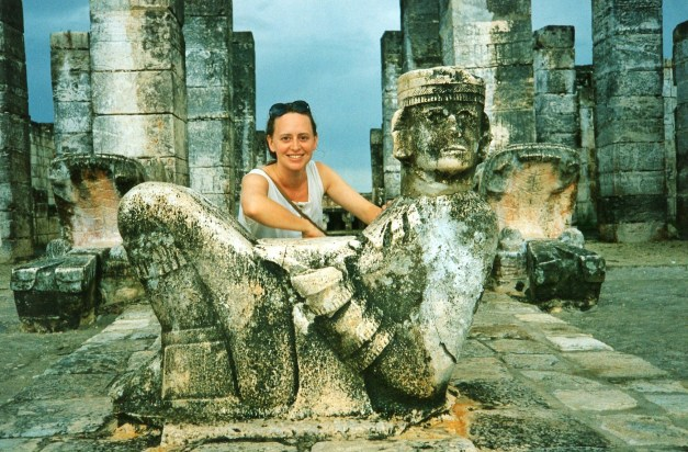 Jeanne poses with the iconic Chac Mool. Today you can't even get to where you can see him.