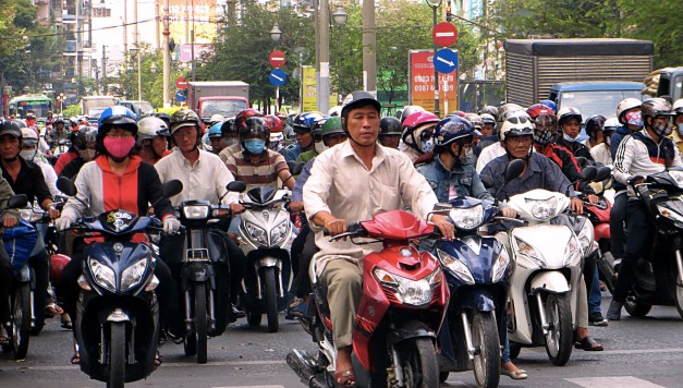 Saigon traffic. Interestingly, Mark notice that everyone wears helmets. Or almost everyone; kids don't. Strange world where every adult wears a helmet but the kids don't.