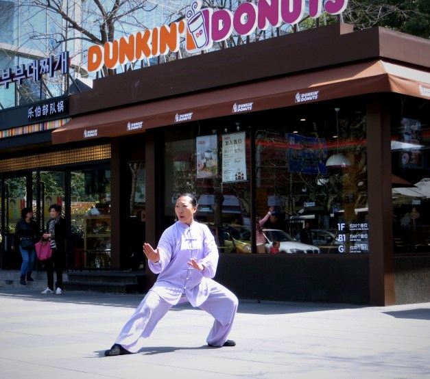 And here was a random woman practicing her Tai Chi in front of a Dunkin' Donuts. There are a LOT of Dunkin' Donuts in Boston, but I've never seen that.