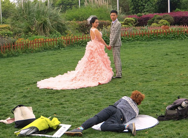 If you're in a park in China, there are going to be many, many bridal couples posing. It's pretty clear these are all pre-wedding pictures, making me wonder how many of the happy couples - who don't always look so happy during the work of posing - actually get to experience the wedding.