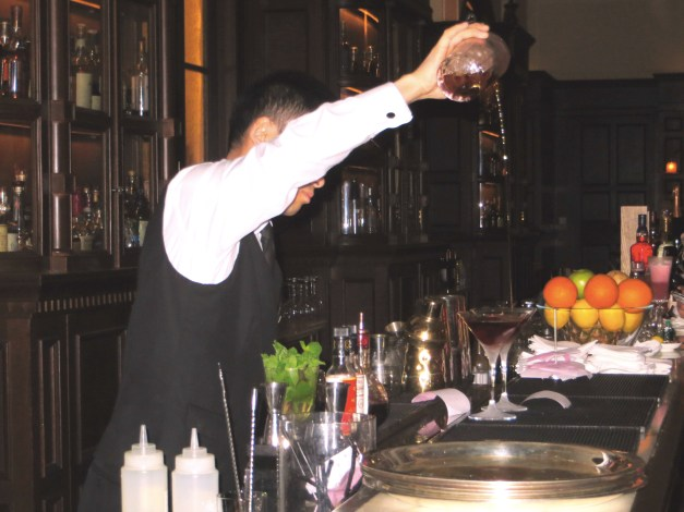A highlight was drinks at the Long Bar in the Waldorf Astoria, an honest-to-God old world glamor experience. Built in 1911, at 110 feet long it was supposedly the longest bar in Asia. Here our bartender is pouring our genuinely perfect Perfect Manhattans.