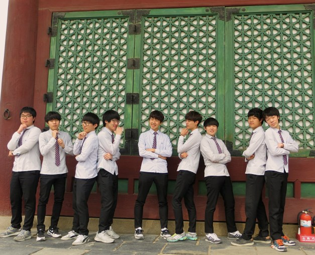 Seoul is the home of K-Pop music and everyone wants to be a star, including these boys posing at one of the ancient palaces