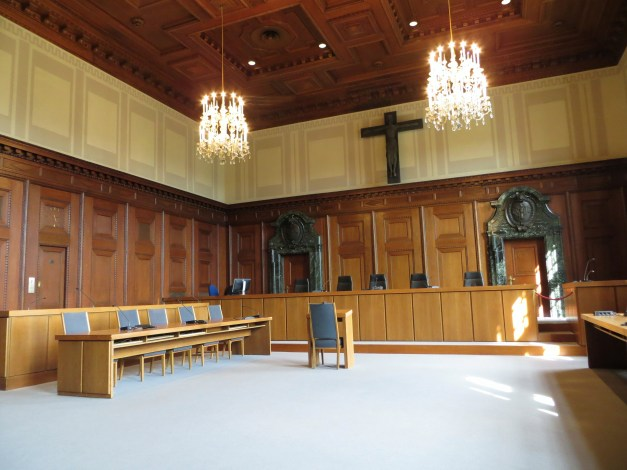 Courtroom 600. In the newsreels of the Nuremberg trials, you see the defendants escorted each day through the little wooden paneled door on the far left and then seated in that box, with Göring in the leftmost corner.