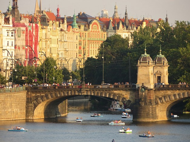 A summer afternoon on the Vltava River with Prague's beautiful buildings in the background