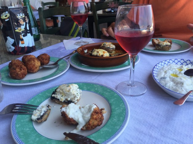 Lunch at the beach, with meatballs, stuffed mushrooms, tzaziki, and a local rosé that was the main attraction