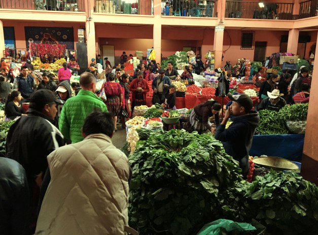 A huge vegetable market. With his green coat, Mark is never hard to find in a crowd.