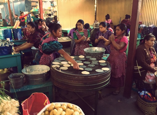 Untold numbers of women all over the market patting out and cooking enormous numbers of tortillas
