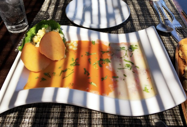 """There was some good food in Iquique. This is a tricolor tiridito, fish """"cooked"""" in citric acid, with the strange lighting provided by a bamboo roof above. You'll note the sweet potatoes on the side; they've been heavenly in this part of the world."""