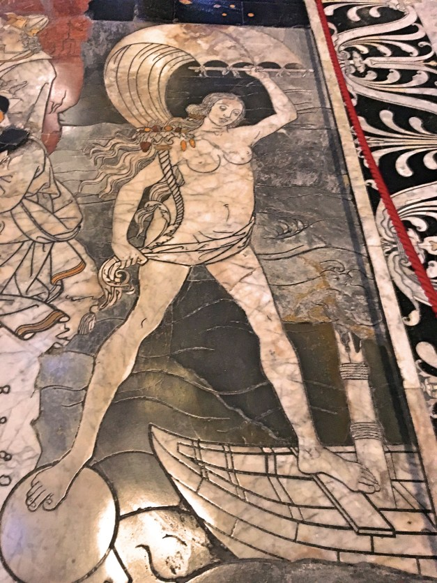 One of the marble inlays on the floor of the Duomo. This is Fortune, showing how unstable good luck can be with one foot on a sphere and the other on a boat with a broken mast.