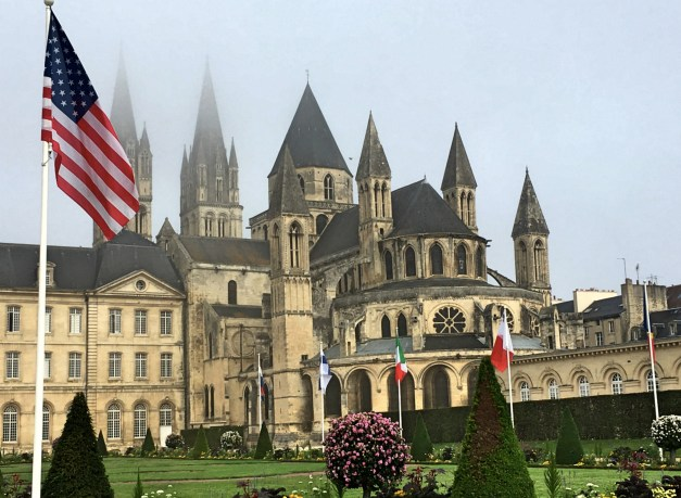 As the fog was lifting we got this view of St. Stephan's. There were flags of many countries in front of City Hall, perhaps in recognition of the role played by the Allies in freeing Caen.