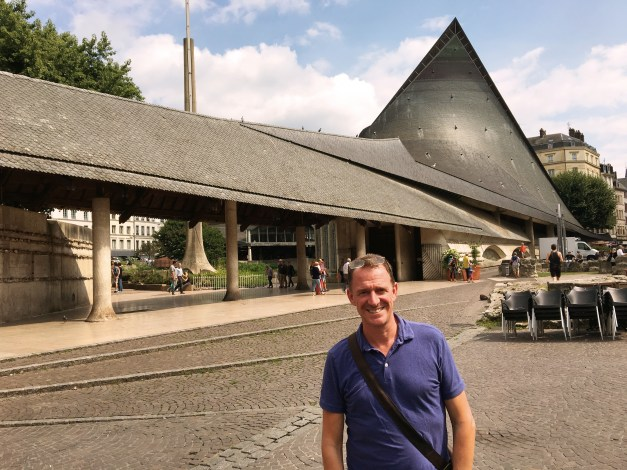 Mark in front of the odd modernist Church of St. Joan of Arc, built on the spot of her martyrdom