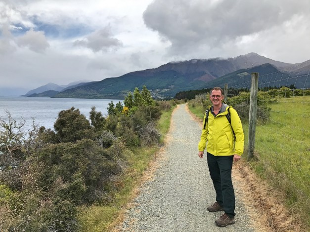 It was always threatening to rain on the hike into Queenstown, but Mark's happy yellow raincoat made it seem bright