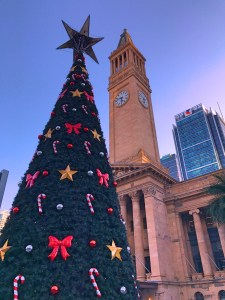 The city's Christmas tree next to the old City Hall in King George Square