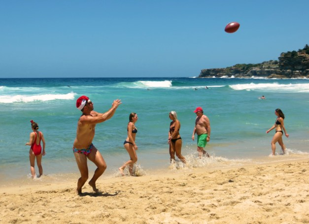 Santa playing football on Tamarama Beach, en route to Bondi. The water was fabulous but the surf was intense; Mark watched the lifeguards drag out one woman who got caught by the tow during the 15 minutes or so I was in the water. Apparently they pull out multiple people every day, but particularly on holidays like this.